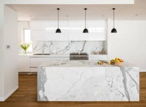 Dark-pendant-lights-offer-visual-contrast-in-the-white-kitchen-filled-with-marble-goodness